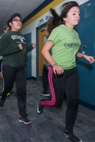 Students run inside during the winter.