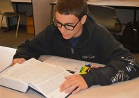 Senior Travis Emmons looks up definitions in a dictionary