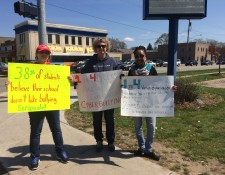 Kelloggsville student Alexandrea Groters and Calvin College student Morgan VonThaden were part of the silent protest last Saturday.